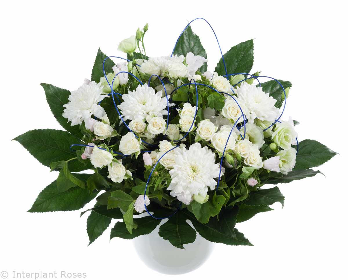white spray roses in bouquet